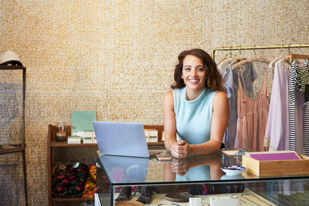 young woman working in boutique